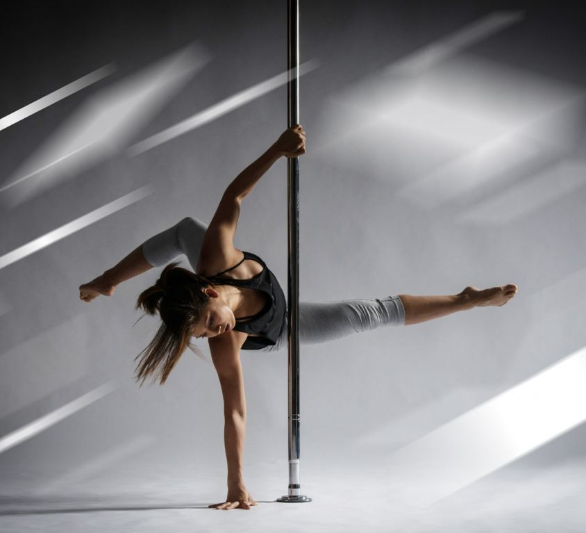 Woman dancing a lyrical pole dance choreography